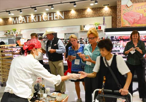Members of the USMEF Heartland Team experience a product tasting at a Tokyo retail store