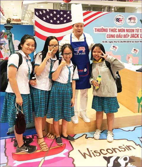 Vietnamese students stop at a U.S. pork retail promotion in Ho Chi Minh City
