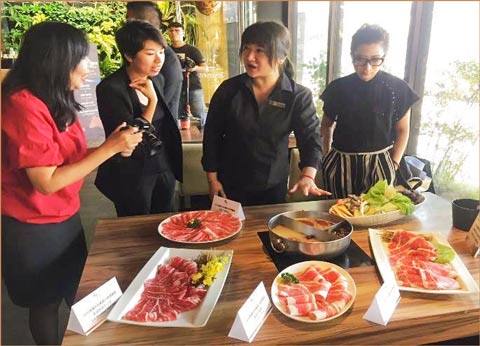 Restaurant staff members explain hot pot dishes made with U.S. beef and discuss U.S. beef as a top option to anchor the dishes