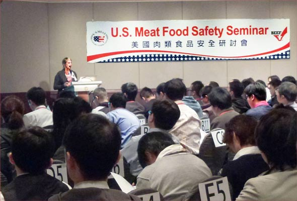 Dr. Hulebak speaks to the crowd during a food safety seminar in Taiwan