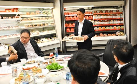 Jack Shao, international sales and marketing manager for Hormel Foods, shows the Korean team packaged U.S. pork and beef items during a review and product sampling at the company's facility