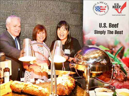 (l. to r.) James Stiegler, acting deputy chief of mission at the U.S. Embassy, joins Jamie Friend of Iowa's Thunder Ridge Beef and Joani Dong of FAS-Malaysia at the ceremony