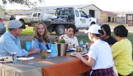 The team enjoys a cookout with Oregon Beef Council CEO Will Wise (far left) and Rebecca Snook (second from left) of Durgan Ranch