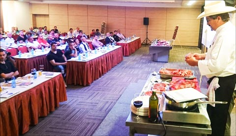 Chef Jay McCarthy demonstrates alternative cuts of U.S. beef available in the Romanian market