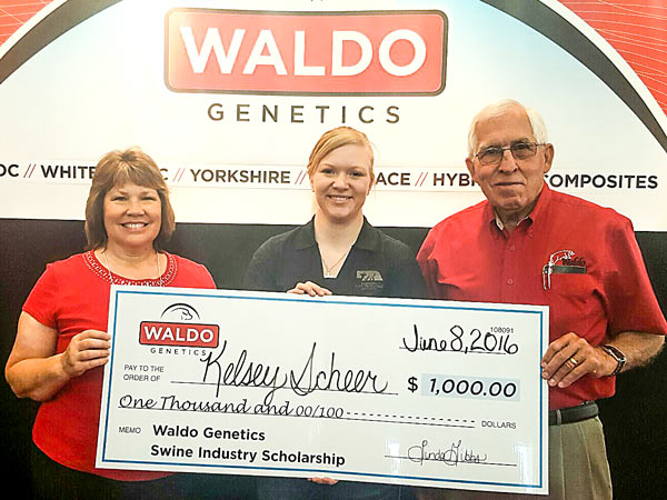 Waldo Genetics CEO Linda Gibbs and owner, Max Waldo, present a $1,000 scholarship check to USMEF intern Kelsey Scheer