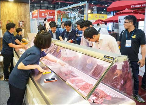 Cuts of U.S. beef and pork were displayed at the expo, and USMEF answered many questions about supplies and pricing