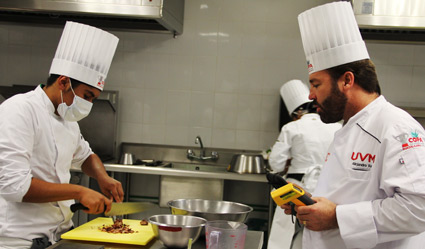 Students under the supervision of Alejandro Kuri (right), chef and owner of La Casa de las Enchiladas restaurants, who served as a competition judge