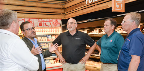 Javier Cordova, director of export sales for Sysco, leads the U.S. industry delegation on a tour of Meat Depot, a high-end retail outlet and restaurant in Santo Domingo that Sysco supplies with U.S. pork and beef