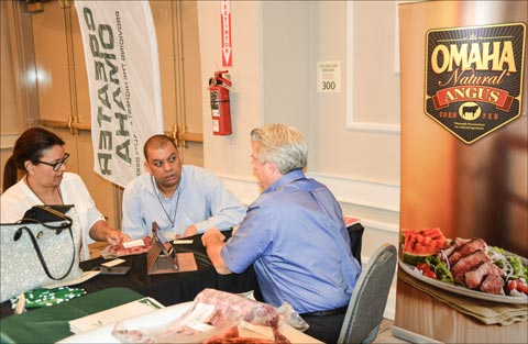 Mark Spengler (right) of Greater Omaha Packing Company meets with prospective buyers at the USMEF Latin American Product Showcase in Santo Domingo, Dominican Republic