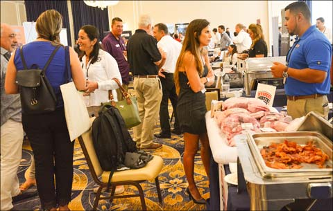 Buyers moved from table to table to learn about U.S. red meat from USMEF member companies during the 2019 Latin American Product Showcase in Puerto Rico