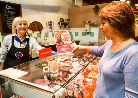 A customer in Riga, Latvia, samples U.S. beef at a retail promotion conducted by USMEF in high-end stores operated by Reaton Ltd.