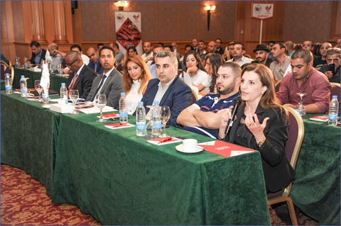 Lina Kanaan (with microphone), USMEF representative in the Middle East, answers questions during a discussion about U.S. beef