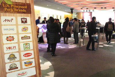 U.S. suppliers and USMEF-Korea staff greet prospective buyers at the inaugural U.S. processed pork showcase in Seoul