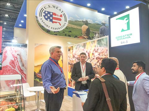 Mark Spengler (left) and Casey Wiggs (center) of Greater Omaha Packing Company meet with prospective buyers at Gulfood 2019