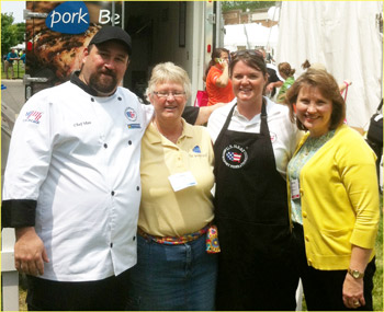 From left, Chef Max Covaliu, Ann Rehnstrom of the National Pork Board domestic marketing staff, Beka Gill and Danita Rodibaugh work the NPB hospitality tent