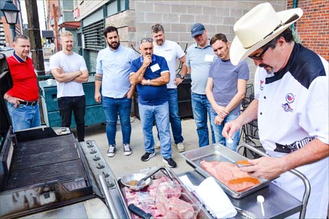 USMEF Chef Jay McCarthy demonstrates to the EU chef team preparation and seasoning of U.S. beef brisket during a barbecue training session in Denver