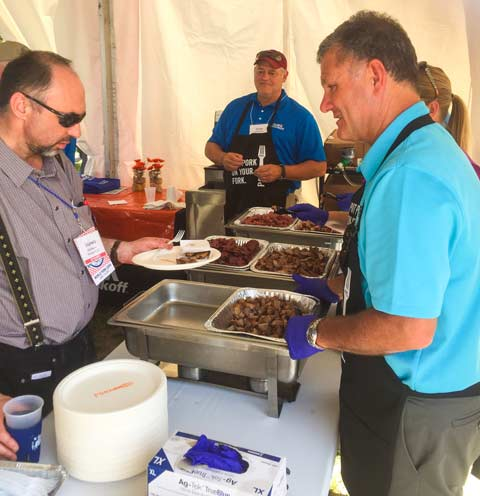 NPB member Mike Skahill, vice president of global affairs for Smithfield Foods, is one of several NPB directors who grilled variety meat samples and answered questions about pork checkoff-funded programs.