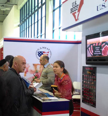 Sergey Korzo of Lamex Foods and Anna Pyzerevskaya of Mirasco discuss product options with buyers
