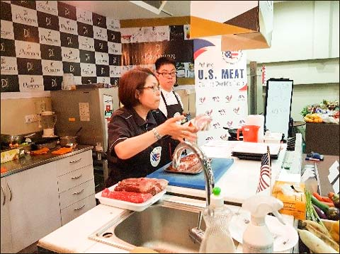 Sabrina Yin, USMEF director in the ASEAN region, conducts a cutting demonstration for chefs at a U.S. meat seminar in Myanmar