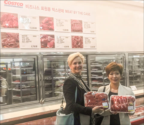 Julie Anna Potts and USMEF-Korea director Jihae Yang view U.S. chilled beef on display at a COSTCO store in Seoul