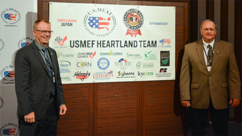 Patrick O'Leary and Gene Stoel of the Minnesota Soybean Research and Promotion Council in front of the Heartland Team banner