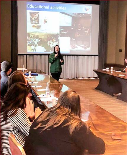 Jessica Julca, USMEF representative in South America, presents an overview of USMEF at the Pork Leadership Institute team's training session in Colombia