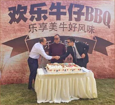 Ming Liang, USMEF marketing manager in China (far right), participated in the ceremony welcoming U.S. beef onto the menus at Peter's Gourmet