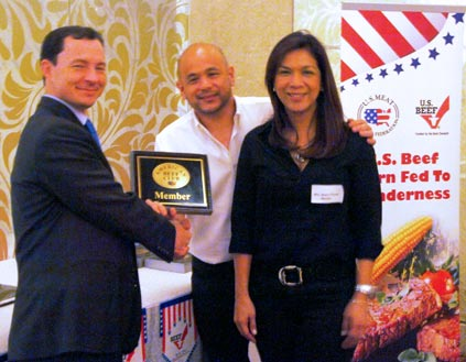 Ralph Bean (left) of FAS-Manila awards a plaque to new American Beef Club members Jorge and Malou Fores, owners of  Mamou Restaurant in Manila
