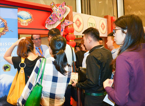 Buyers gather at the Platte Valley Food Group booth in Beijing