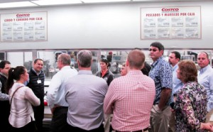 The delegation tours the meat department at a Costco store in Mexico