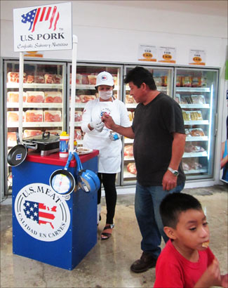 Customers enjoy grilled U.S. pork samples in Campeche, Mexico