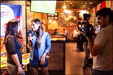 Jessica Julca, left, USMEF director in South America, is interviewed on-camera during the U.S. Pork Ribs Festival