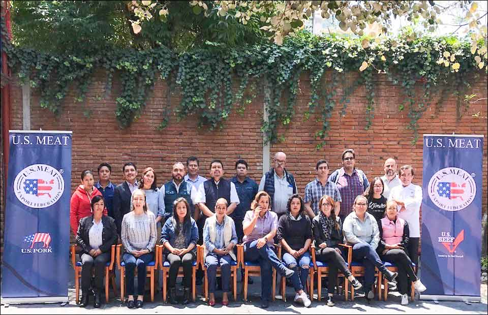 Participants in the U.S. pork and beef cutting and cooking seminar in Puebla, Mexico pause for a group photo