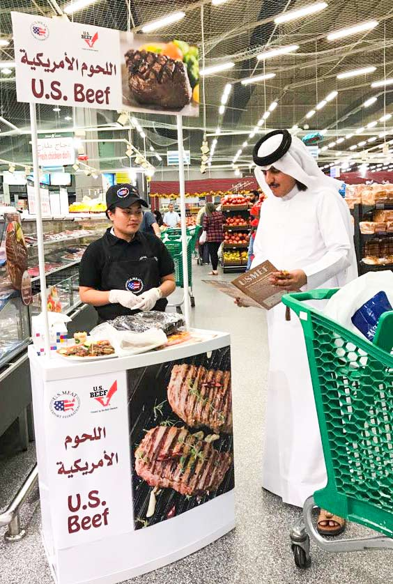 A consumer studies educational material while sampling U.S. beef at one of 40 promotional activities in Dubai and Qatar