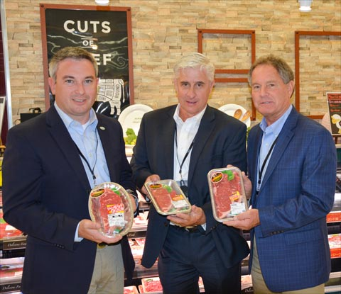Heartland Team members from Kentucky (from left, Agriculture Commissioner Ryan Quarles, Dave Maples and Ray Allan Mackey) examine packaging of U.S. beef and pork on display at Japanese retail stores