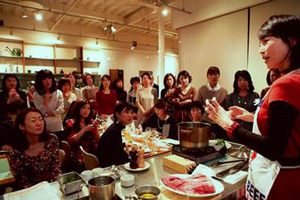 Rika Yukimasa conducts a holiday cooking demonstration