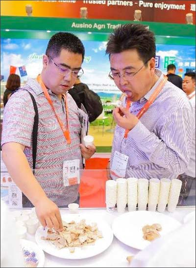 Buyers from several sectors of China's food industry sampled U.S. pork dishes at SIAL China
