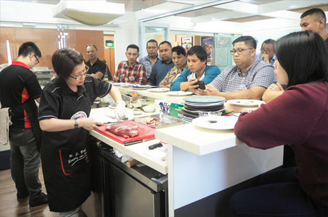 Sabrina Yin, USMEF director in the ASEAN region, provides a U.S. beef cutting demonstration to Indonesian chefs and foodservice industry professionals