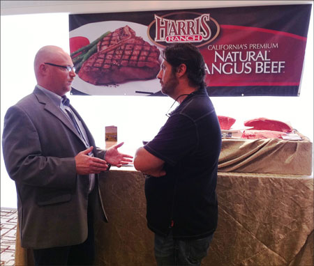 Sam Smith, sales manager for One World Beef, talks to a customer at the Singapore Hilton