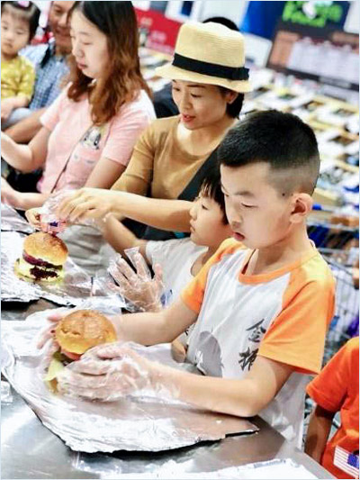 Chinese shoppers and their children participated in a burger making contest that was part of U.S. beef promotions at two Sam's Club locations in Shanghai