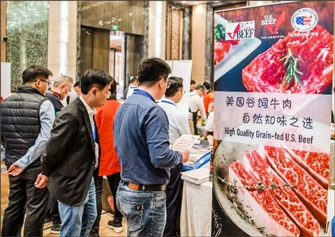 Visitors to the Shanghai Nissei Food Show line up at the USMEF booth to sample and gather information about U.S. beef