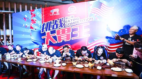 A U.S. pork-eating competition was part of the Foodie Festival event in Beijing