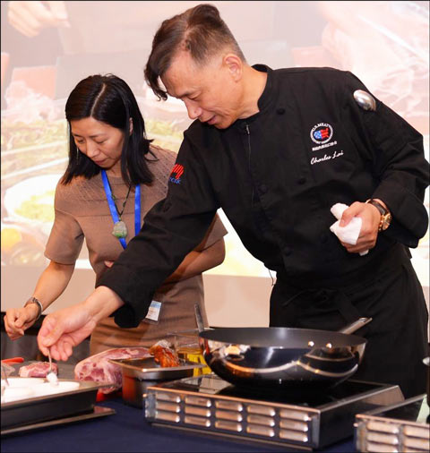 Chef Charles Lai cooked U.S. pork and invited members of the audience to participate