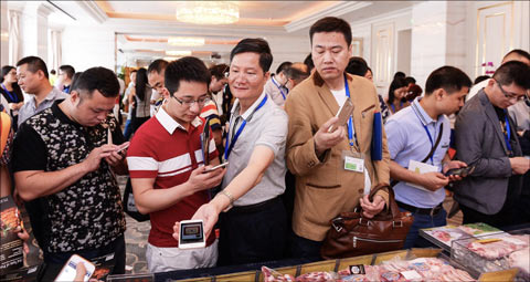 Chinese traders showed great interest in the U.S. pork products on display