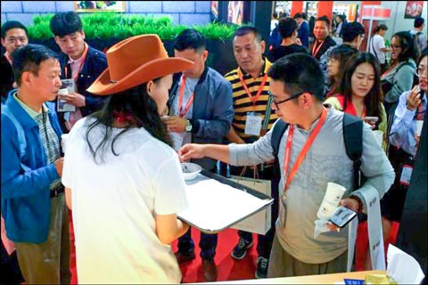 Tasting samples of U.S. beef and pork were offered to visitors to the USMEF booth during SIAL China
