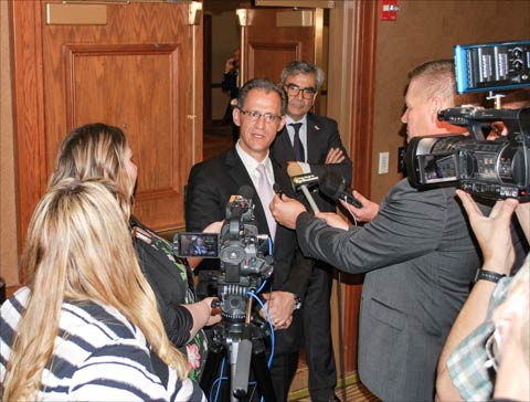 Kenneth Smith, chief NAFTA negotiator for Mexico, speaks with reporters covering the World Meat Congress