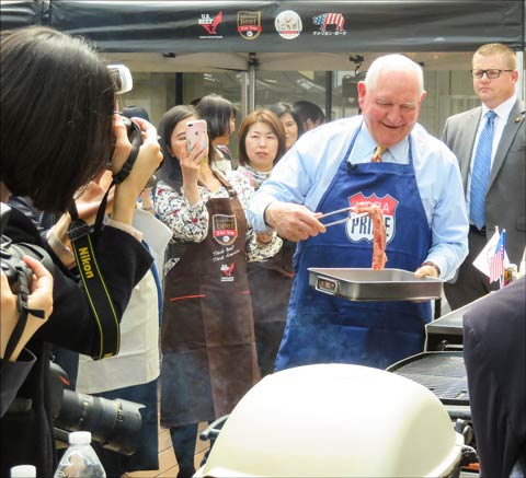 Using his family's special sauce recipe, Perdue prepares U.S. beef and pork at the USMEF Urban Barbecue event