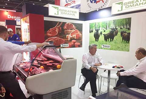 Mark Spengler (center), export sales general manager for Greater Omaha Packing Company, meets with a prospective customer during Gulfood 2017 in Dubai