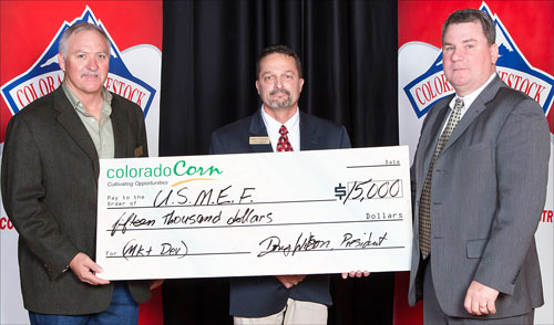 (from left to right) Colorado Corn Market Development Action Team Chairman Mike Lefever and Colorado Corn Executive Director Mark Sponsler present a check to USMEF Assistant Vice President for Industry Relations John Hinners