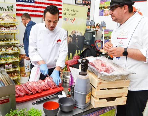 Chef Stefan Popescu prepares U.S. beef at the Taste Ambassadors exhibition in Bucharest, Romania